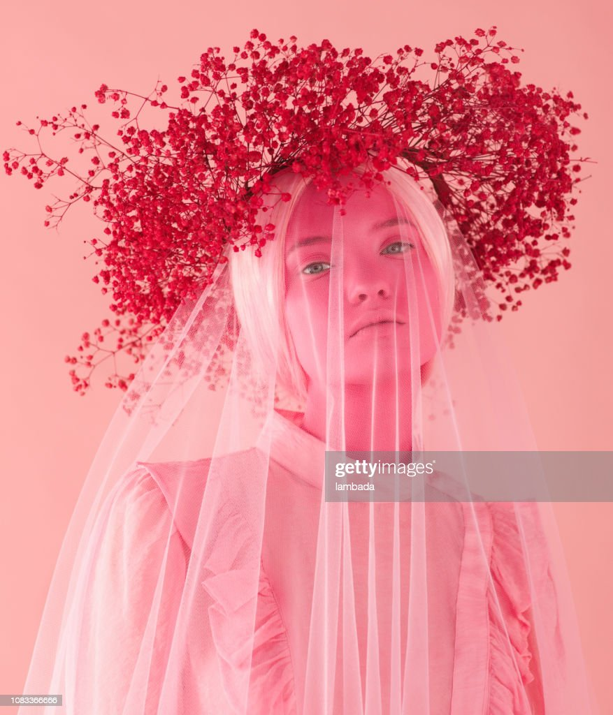 Woman with pink skin, pink wreath and clothes : Stock Photo