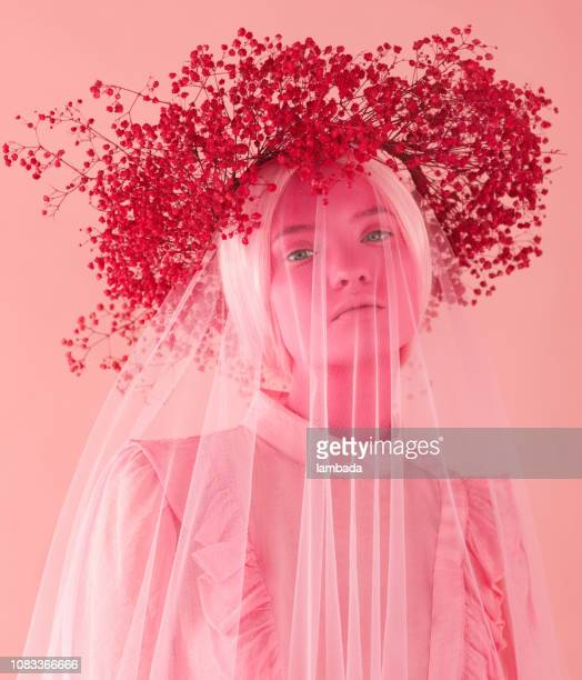 Woman with pink skin, pink wreath and clothes