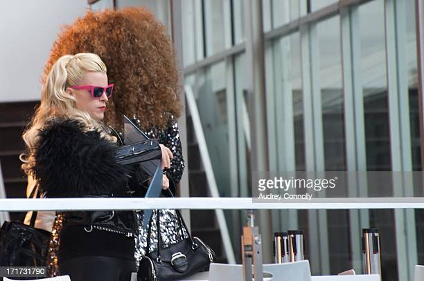 CONTENT] woman with pink sunglasses at Bryant Park in midtown Manhattan New York City