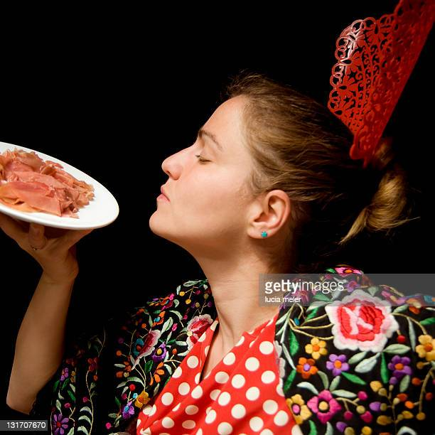 Woman with plate of ham