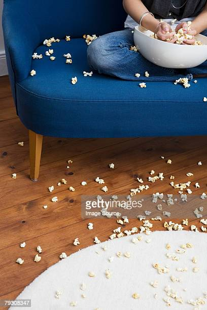 woman with popcorn mess - floorboard stock photos and pictures