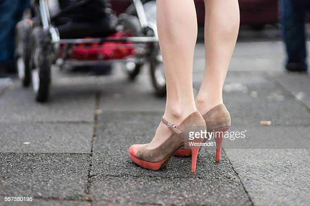 woman with pram wearing high heels - suede shoe stock pictures, royalty-free photos & images