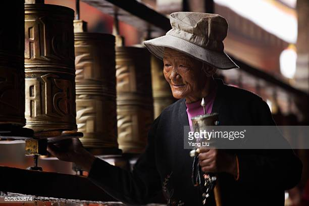 Woman with Prayer Wheels at Jokhang Temple