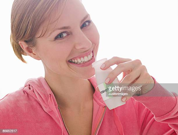Woman with probiotic drink