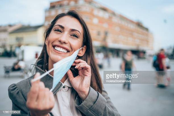 woman with protective face mask outdoors. - removal stock pictures, royalty-free photos & images