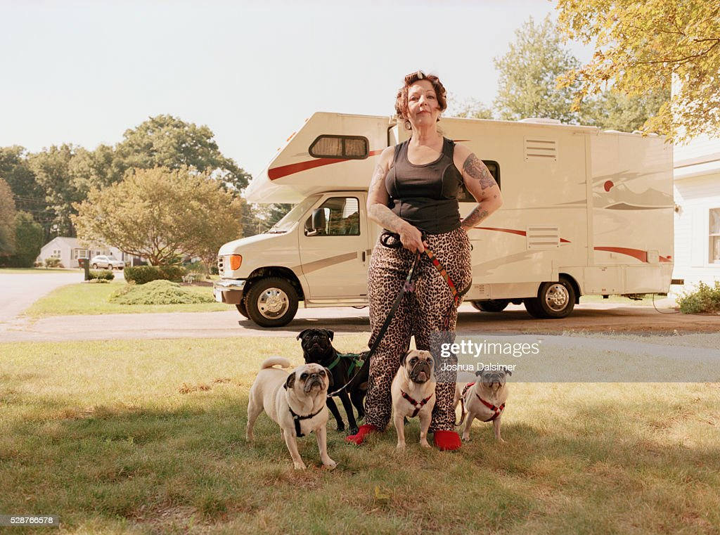 Woman with pugs : Stock Photo