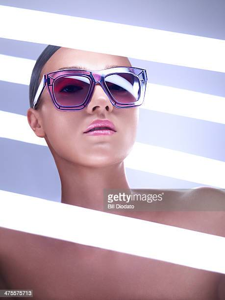 Woman with purple sunglasses and neon lights