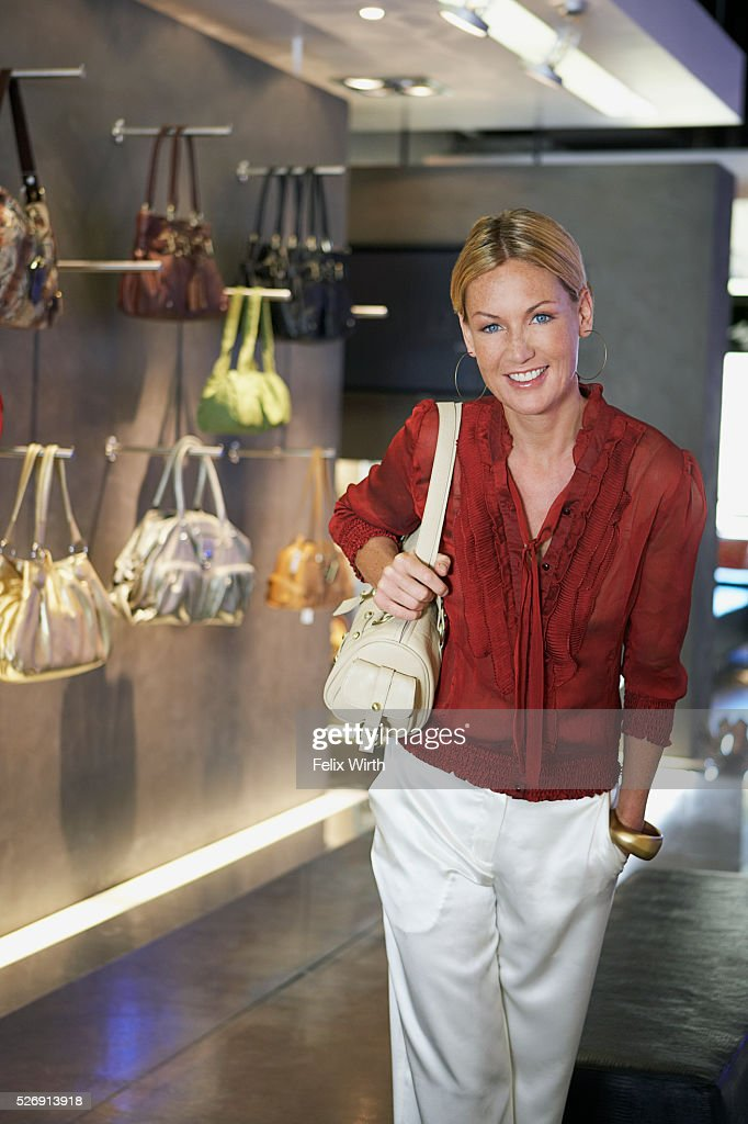 Woman with purse : Stock Photo