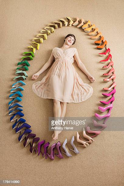 Woman with rainbow coloured shoes in oval shape