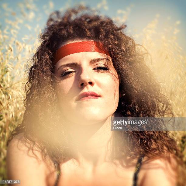 Woman with red band on head biting her lips