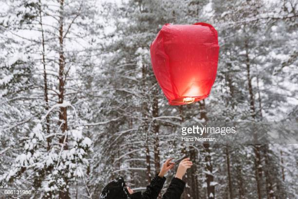 Woman with red chinese lantern