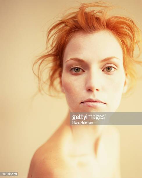 Woman with red hair and bare shoulders