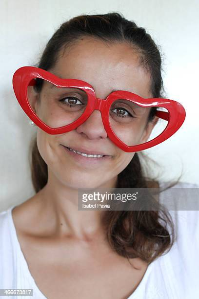 Woman with red heart glasses