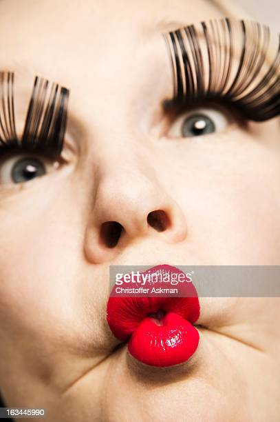 woman with red lips and big eyelashes - big lips stock photos and pictures