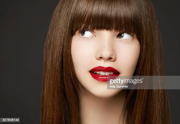 woman with red lips thinking