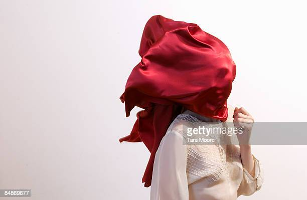 woman with red silk blowing over face