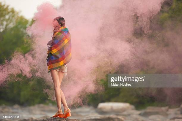 woman with red smoke around her