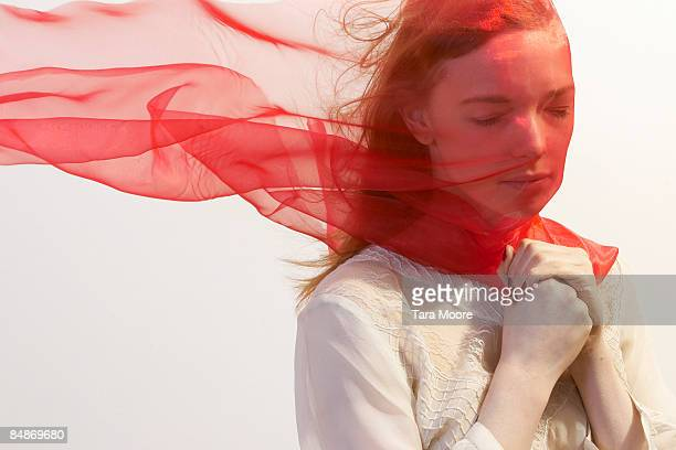 woman with red veil blowing over face - veil stock pictures, royalty-free photos & images