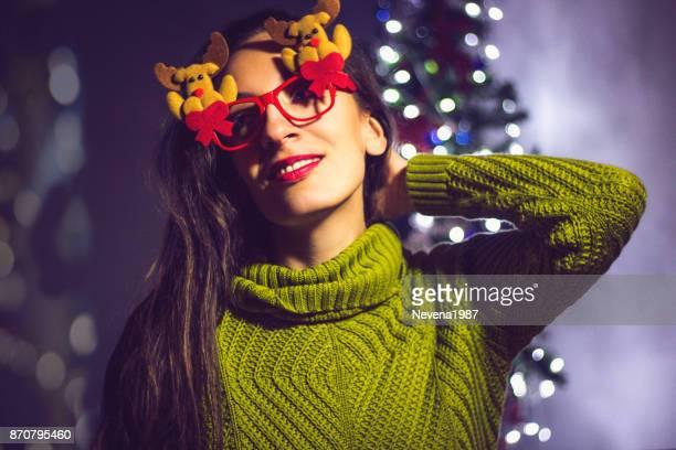 woman with reindeer eyelgasses