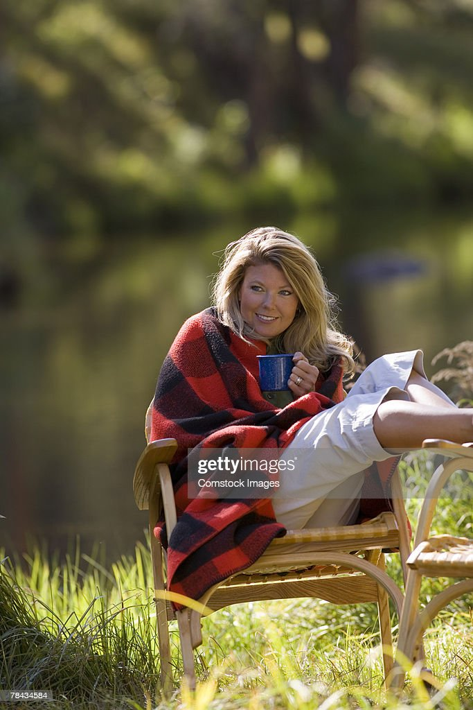 Woman with relaxing outdoors with coffee : Stockfoto