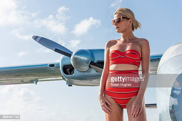 woman with retro look in front of old airplane - sexy hot lady stock pictures, royalty-free photos & images