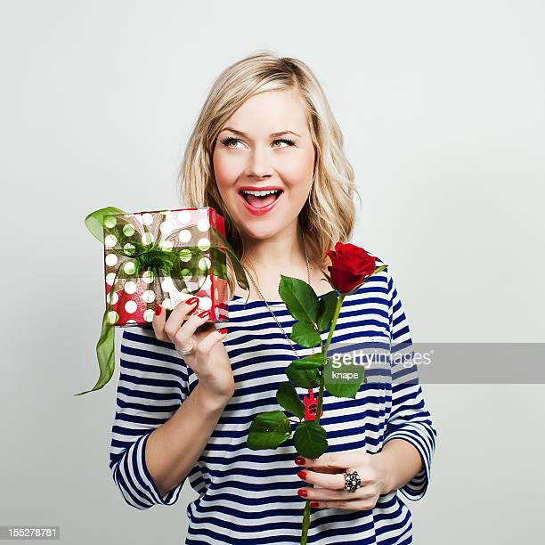 Woman with rose and gift for valentine
