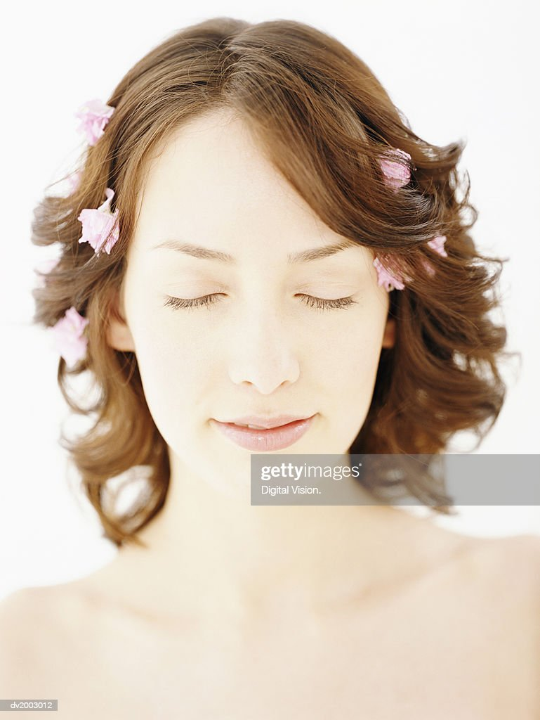 Woman With Rose Petals in Her Hair : Stock Photo