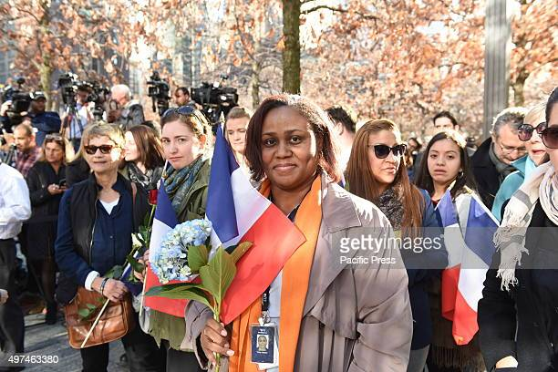 Woman with roses and Tricolour flag Several hundred New Yorkers gathered at the 911 Memorial at Ground Zero to lay flowers at the base of the...