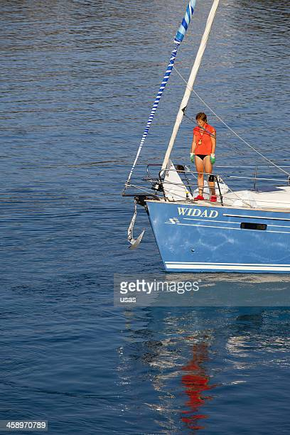 Woman with Sail Boat at Aegean Sea