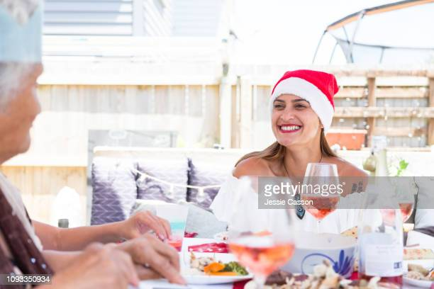 Woman with santa hat smiling at mother