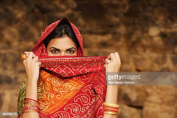 woman with sari covering face