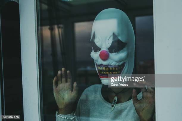 woman with scary clown mask - clown stock pictures, royalty-free photos & images