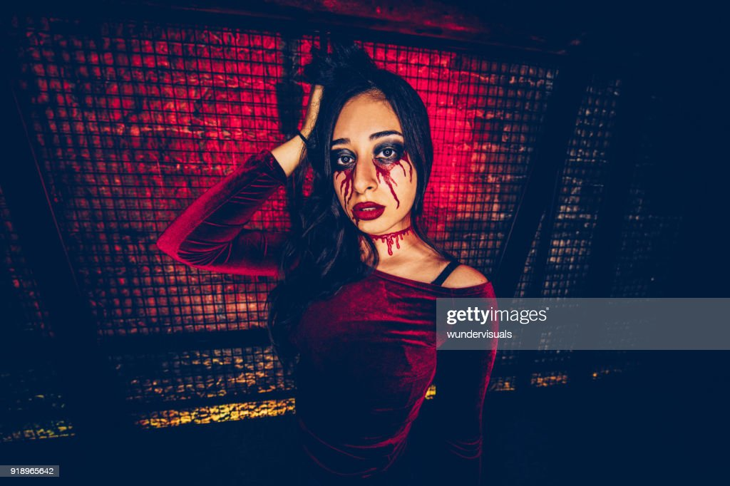 Woman with scary make-up celebrating Haloween at dungeon party : Stock Photo