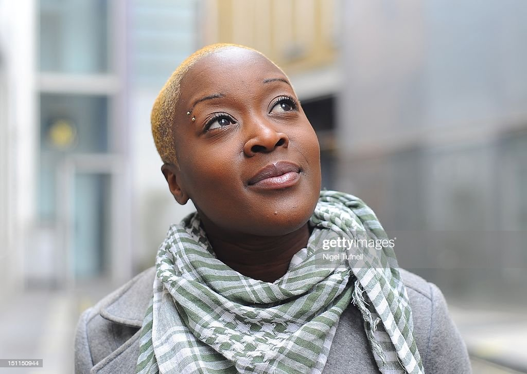 Woman with shaved head : Stock Photo