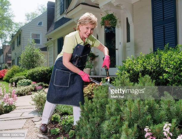 Woman with Shears in Garden