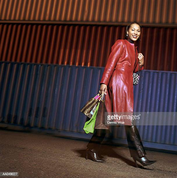 woman with shopping bags, cargo containers in background, portrait - frock coat stock pictures, royalty-free photos & images