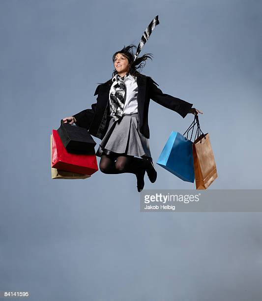 Woman with shopping bags, jumping