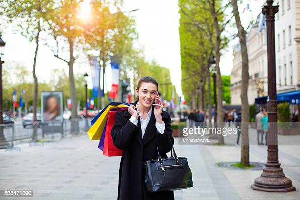 Woman with shopping bags, Paris.