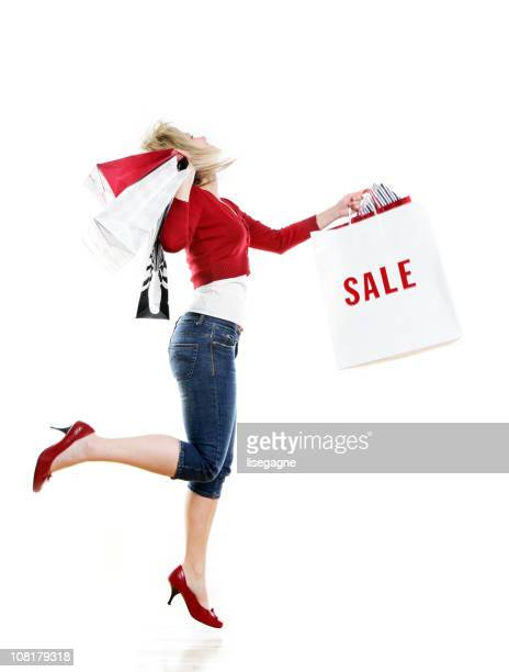 ショッピングバッグを持つ女性 - ハイヒール ストックフォトと画像