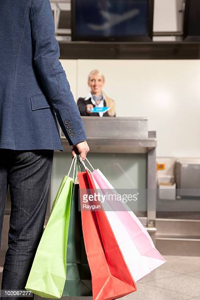 Woman with shopping bags traveling