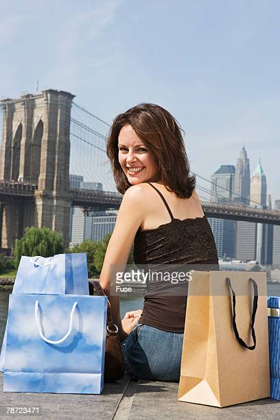 Woman with Shopping Bags Viewing Brooklyn Bridge