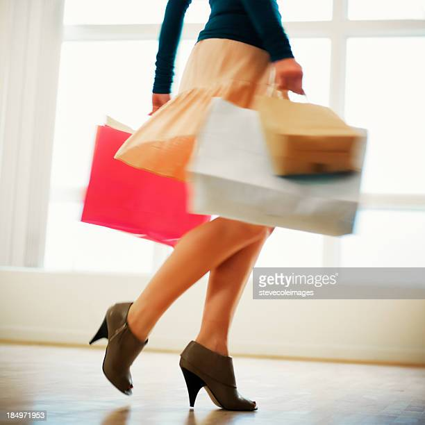 Woman With Shopping Bags Wearing High Heels