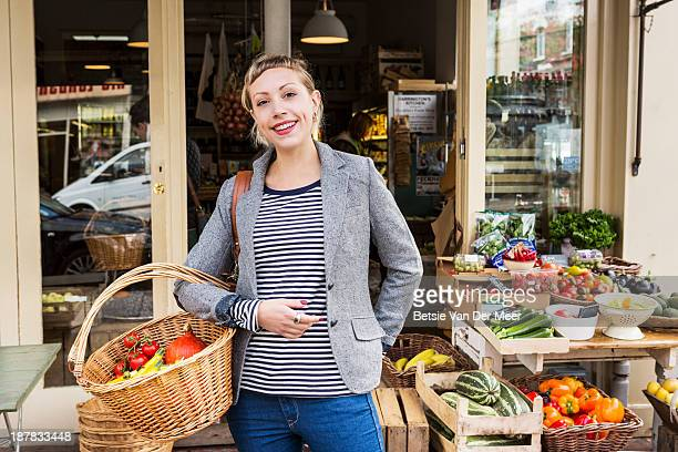 Woman with shopping basket with organic vegetables