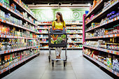 woman with shopping between store shelf portrait copy space