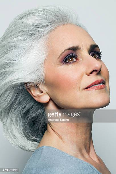 Woman with silvery hair looking up, portrait.