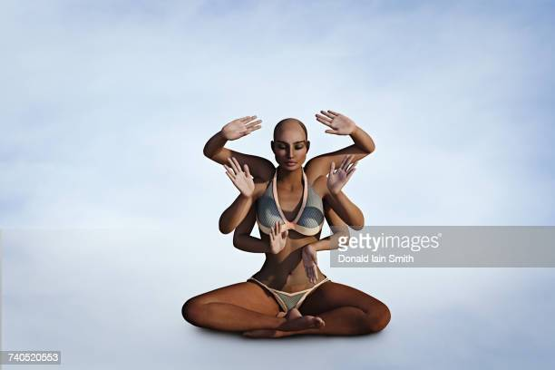 Woman with six arms meditating