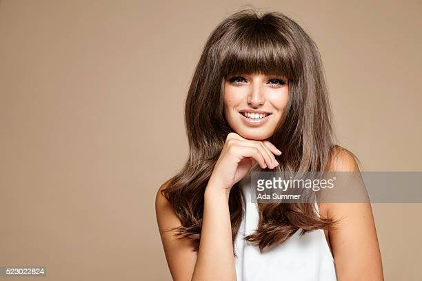 woman with sixties style make-up smiling