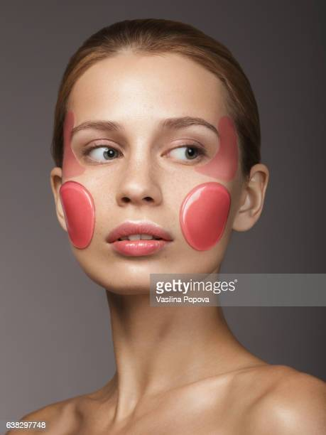 Woman with skin care gel patches