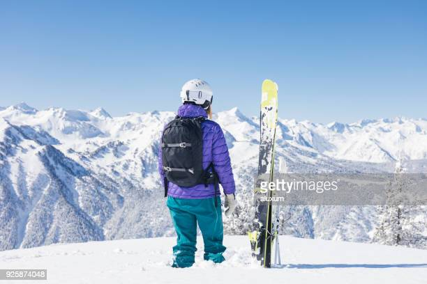 woman with skis looking at the pyrenees mountains - female skier stock pictures, royalty-free photos & images
