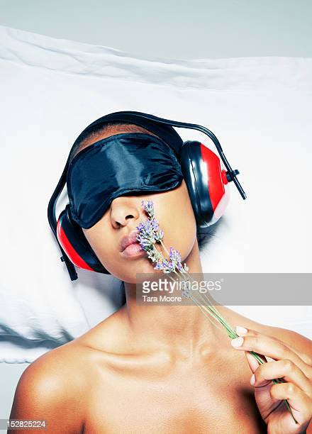 woman with sleeping mask,lavender,ear protectors